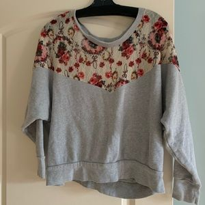 Free People sweater with floral lace pattern